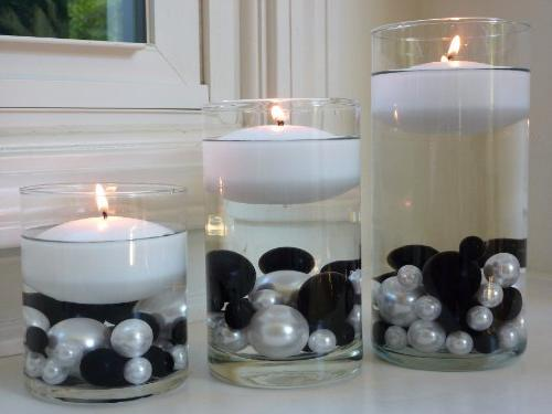 3 white floating candles value